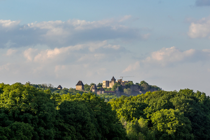 Helfstyn castle view of the surrounding forest and rapeseed field lying below the castle during a sunny day. , Czechia, Olomouck媒 kraj, T媒n nad Be膷vou