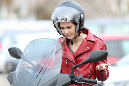 Angry biker on a broken down motorbike
