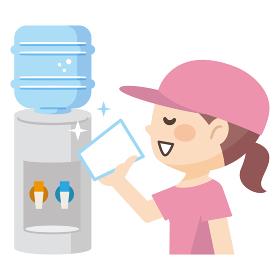 ウォータークーラーの水を飲む若い女性