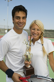 Mixed doubles Tennis Players on tennis court holding trophy portrait
