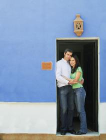 Couple embracing in doorway