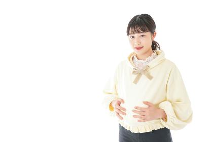 私服姿の若い妊婦の女性