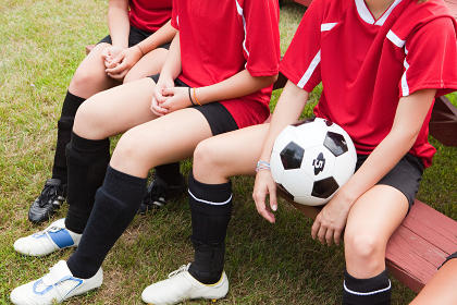 Cropped shot of girl soccer players