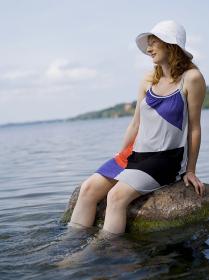 Woman sitting on rock in water