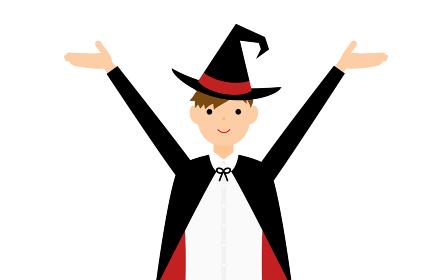 ハロウィンの仮装、魔法使い姿の男の子が両腕を上げるポーズ