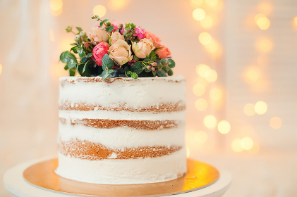 Decorated by flowers white naked cake, rustic style for weddings, birt