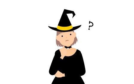 ハロウィンの仮装、魔女姿の女の子が腕組みして悩むポーズ
