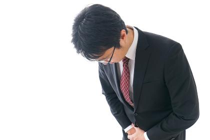 謝罪をするビジネスマン・謝罪会見