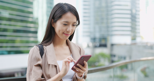 Young woman work on cellphone at outdoor