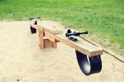 close up of swing or teeterboard on playground