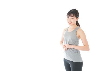 スポーツウェアを着た若い女性
