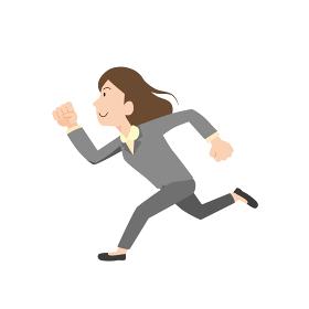 力強く走る女性会社員