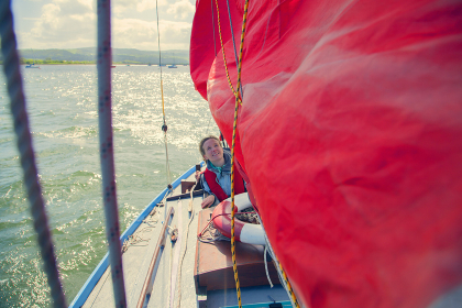Mid adult woman on sailing boat
