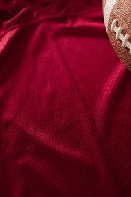 Cropped image of American football on jersey
