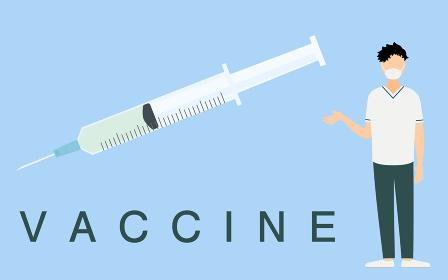 ワクチン接種を勧めるマスクをした医療従事者