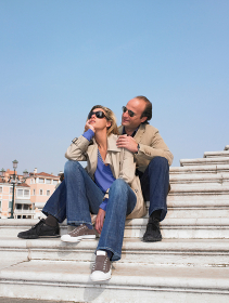Couple on stairs by the marina