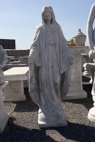 Stone sculpture of virgin mary in reclamation yard. art and classical style romantic figurative stone sculpture.