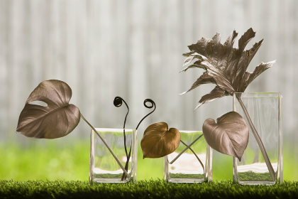 Silver and gold leaves in vases