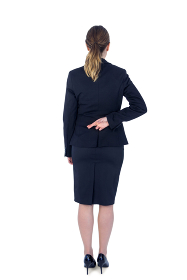 Pretty businesswoman with finger crossed