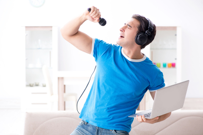 Young man singing at home karaoke