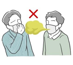 マスクをした口臭がきつい若い男性と鼻をつまむ若い男性