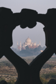 Taj Mahal seen in the distance from Agra Fort at sunset, Agra.