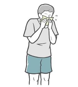 鼻をかむ中年男性