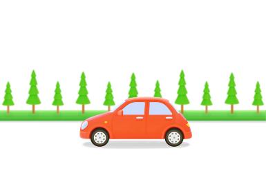赤い車と街路樹