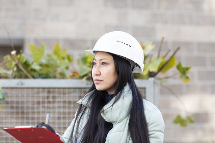 worker asia woman with winter jacket working outside