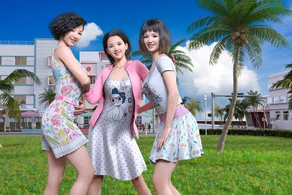 エネルギッシュな20代の女子が3人で休日に楽しそうに野外の芝生の上で集まって遊んでいる