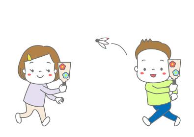 羽子板で羽根つきをして遊ぶ子供たち