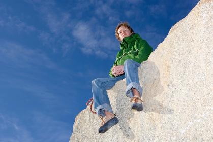 Climber sitting on mountain peak