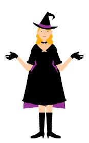 ハロウィンの仮装、魔女姿の女性が両腕を広げるポーズ