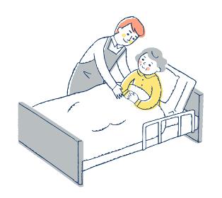 ベッドにいるおばあちゃんと男性介護スタッフ