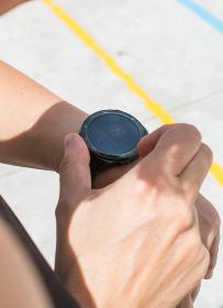Unrecognizable Sportswoman Checking Smart Watch.