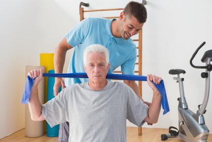 Senior man training with his coach