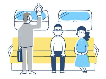 一定の距離をとって電車に乗る人々