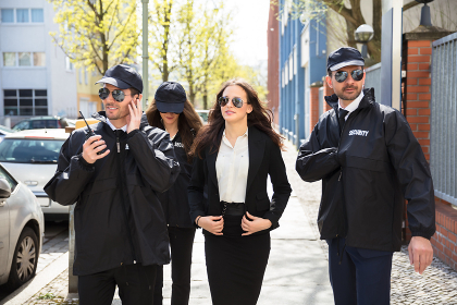 Portrait Of Female Celebrity With Bodyguards