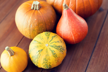 close up of pumpkins on wooden table at home