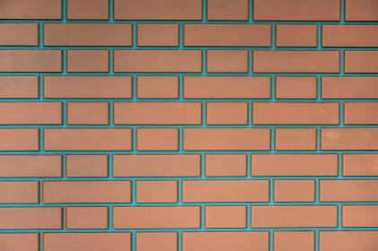 Background wall of modern red bricks fastened with cement