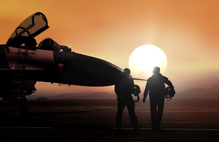 Fighter pilot and supersonic jet on military airbase during sunset
