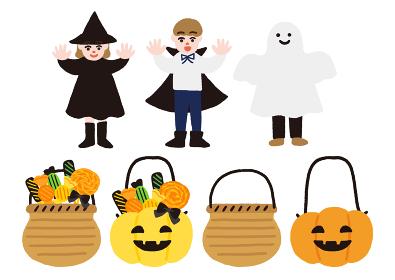 ハロウィンの仮装をした子供たちとキャンディーの入ったカゴ