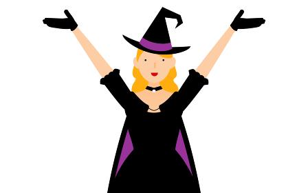 ハロウィンの仮装、魔女姿の女性が両腕を上げるポーズ