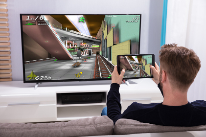 Man Connecting Game On Television Through Wi-fi On Tablet