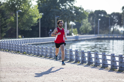 Young athletic man practicing running with shorts and shirt , Madrid, Community of Madrid, Spain