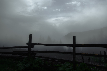 wooden fence farm in the mountains