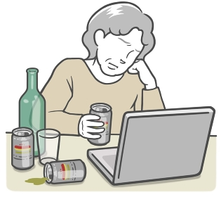 ノートPCを見ている、アルコール依存症の中年女性