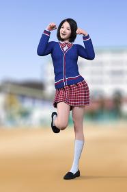 グラウンドで青いカーディガンを着たショートヘアの女子高生が可愛く招き猫のポーズをする