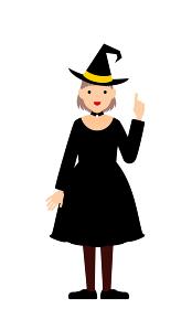 ハロウィンの仮装、魔女姿の女の子が指さしをするポーズ