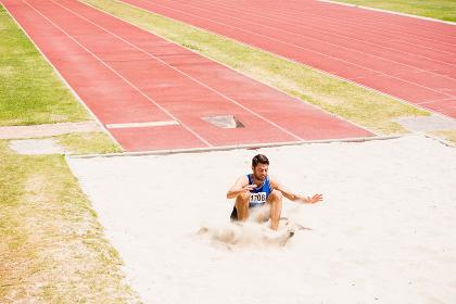 Athlete landing on sandpit